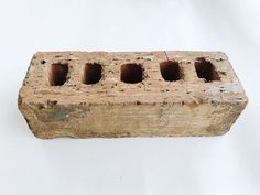 I found an old brick at our rental house the other day when we were doing yard work.  It looks like any old building brick but when I saw the holes, it reminded…