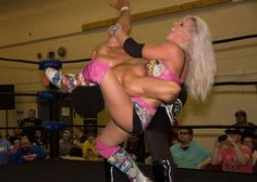 Candice LeRae with an Octopus Hold on Brent Banks