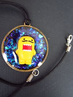 Glittery kawaii Domo Kun charm necklace with iridescent glitter encased in resin…