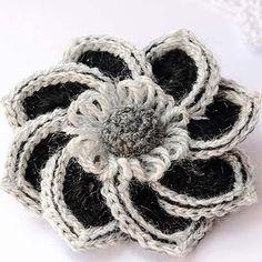 Crochet Flower Brooch  This pretty crochet flower brooch is from an easy-to-follow diagram