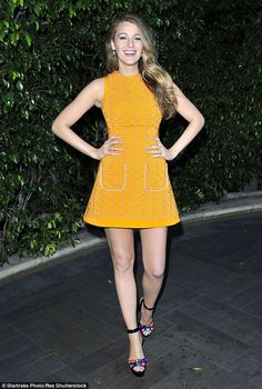 Looking leggy: The starlet displayed her slender legs in the short dress, which she paired with gem heels