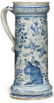 A SOUTHWARK DELFT DATED BLUE AND WHITE MUG  1630, PROBABLY CHRISTIAN WILHELM, PICKLEHERRING QUAY  Of tall cylindrical form with swelling top rim and base and angular loop handle, boldly painted with 'bird-on-rock' decoration with four birds falling from the sky above and flanked by stylised flowering plants, a flourish and the date 1630 beneath the handle, between borders of concentric line and diagonal dash and dot-ornament  9¾ in. (24.8 cm.) high