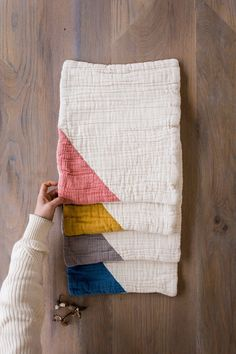Sandwiched inside unbleached organic cotton gauze is a layer of organic cotton batting for extra absorbency. Naturally hand-dyed triangle in the corner. Gauze Fabric, Pink Fabric, Luxury Kids Clothes, Shoe Size Chart Kids, Baby Coat, Baby Burp Cloths, Natural Baby, Baby Sewing, Accent Colors