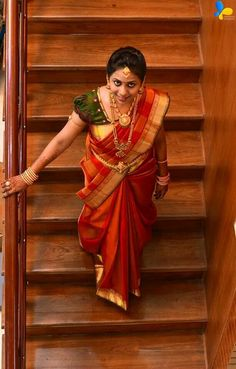 South Indian Bride in Orange Silk Saree and Green Blouse