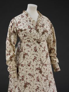 """Victoria & Albert Museum, item T.355-1980; 1795-99, block printed cotton.    The dress is styled with a high-waisted , fitted bodice, which fastens centrally. The neck, which is trimmed with a 1"""" frill of matching material, is rounded a the back and V-shaped at the front. The bodice is lined with white cotton which extends 1/3 of the way down the full length tapered sleeves."""