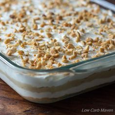 This Low Carb Peanut Butter Layered Dessert is a ketogenic dream! Peanut flour crust, silky cream cheese, rich peanut butter pudding & whipped cream. GF