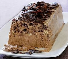 Chocolate-Amaretto Semifreddo Studded with dark cherries and toasted almonds, this creamy frozen dessert is a cinch to make. Italian Chocolate, Chocolate Coffee, Chocolate Desserts, Delicious Desserts, Dessert Recipes, Yummy Food, Yummy Mummy, Chocolate Shavings, Toasted Almonds