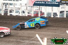 #43 the Brian's Body Shop sponsored Midwest Modified of Rory Opp racing hard at The Legendary Bullring River Cities Speedway from Grand Fork...