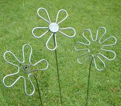 Steel sculptures of three small flowers www.ironvein.co.uk