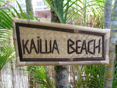 """This is a hand made bamboo """"Kailua Beach"""" sign. Has bamboo framed and backed with a woven mat. It measures 19 1/2 inches X 10 inches."""