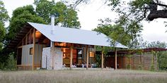 Texas architect Trey Rabke reimagines his family's country getaway, tying the design firmly to the land around it