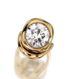 DIAMOND RING, RENÉ BOIVIN.  Collet-set with a circular-cut diamond, on a plain yellow gold asymmetrical mounting,  unsigned, French assay and maker's marks, fitted case signed René Boivin Paris.