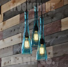 This is a 3-Pendant chandelier made from 3 recycled tear drop shaped bottles that are hand cut and polished smooth. At 15 tall and 4 wide, they