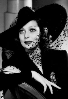 Loretta Young in a 'wow' hat with veil (1940s)