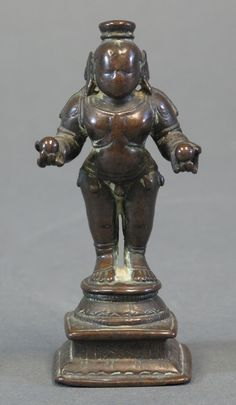 Lot 78 - KRISHNA  South India, circa 18th century bronze, the infant deity with hands outstretched, each