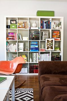 Make square bookshelves interesting by varying content and colour