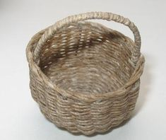 Jane Harrop shows us how to weave a miniature dolls house basket using the stake and strand method with paper covered wire and waxed linen thread. ...