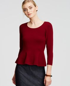 Cast in a palette of fall's richest colors, this must-have peplum tops off a look with just the right touch of feminine flounce. Jewel neck. Long sleeves. Peplum hem.