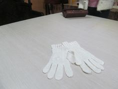 First Communion gloves done in the Shantou style, intended for export to United States or Mexico.  Stored at Shantou Yuhong Artex and Embroidery Research Institute, Shantou, Guangdong Province, China.
