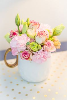 Flowers in a mug: http://www.stylemepretty.com/living/2015/04/13/a-sophisticated-city-themed-nursery/ | Photography: Threaded Together - http://threadedtogetherblog.com/