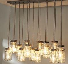 Mason jar pendant light with edison bulbs from Pottery Barn.I love mason jars! Mason Jar Pendant Light, Mason Jar Light Fixture, Mason Jar Chandelier, Diy Chandelier, Light Fixtures, Pendant Lights, Jar Lamp, Country Chandelier, Bottle Chandelier