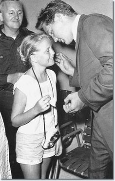 Elvis...... with a happy young fan.  = )