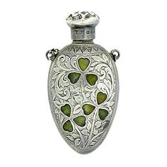 Irish sterling perfume bottle inset with with clovers.