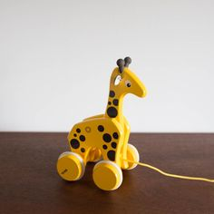 Want some fun company on your walk? Why not take this wooden toy giraffe along? The giraffe moves its neck and head as you pull it. This retro designed pull-along giraffe will encourage early walking