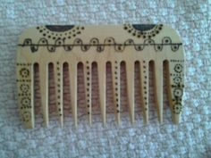 Wooden hair comb with pyrography . Crafts for today