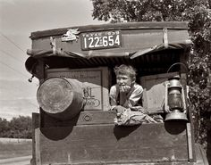 June 1939. Migrant child in family car east of Fort Gibson. Muskogee County, Oklahoma. View full size. 35mm nitrate negative by Russell Lee.