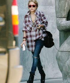 casual grunge street style inspo. mary kate olsen: style icon. one of olsen twins, the row, ashley olsen. plaid tartan lumberjack shirt. ripped jeans boots balenciaga layered necklaces
