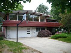 MCM raised ranch in Michigan only $149,000... 4 bedrooms, 2 bathrooms, a million windows! How great is that garage door!