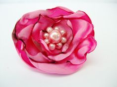 A personal favorite from my Etsy shop https://www.etsy.com/listing/188470318/pink-fabric-flower-ring-adjustable-pink