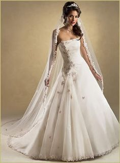 I love the veil; the dress looks too prom-y, but it's gorgeous as well