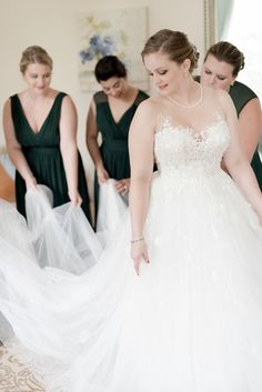 Bride and her bridesmaids in getting ready suite at Rust Manor House wedding
