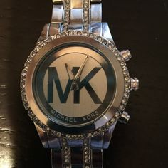 Michael kors watch- Never worn-got as a Christmas present-I have an average wrist and it could use about 2 links taken out Michael Kors Jewelry