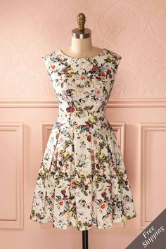 Floral dress with box pleated skirt.