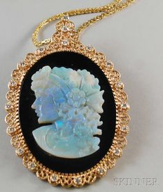 Large 14kt Gold And Diamond Framed Onyx And Opal Cameo Pendant Depicting A Woman In Profile, Mounted In A Wirework Frame, Suspended From A 14k Gold Box Link Chain