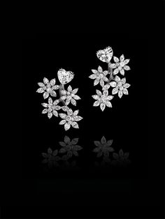 "TREMBLEUR ""BRANCH"" EARRINGS Earrings featuring 2 heart-shaped diamonds weighing respectively 3.77cts and 4.01cts (E. VS1), 18 marquise-shaped diamonds weighing 3.88cts, 40 pear-diamonds weighing 9.40cts and brillant diamonds weighing 2.29cts."