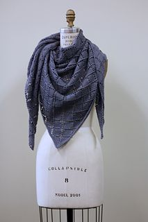 Dorothea is a generously sized all-seasons shawl knit with a simple, easy to memorize lace motif. The shawl is worked from the center out.