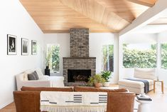 By removing the walls that made up the original bungalow's small, cramped rooms, Nwakpa Gillespie created a spacious living room. She added windows and vaulted the ceiling, giving the space an airy and expansive feel. #dwell #beforeandafter #modernhomerenovations #fireplaceideas Spacious Living Room, Living Spaces, Modern Fireplace Decor, Edison House, Beach Bungalows, Coeur D'alene, Coastal Homes, Interior Design, Venice Beach
