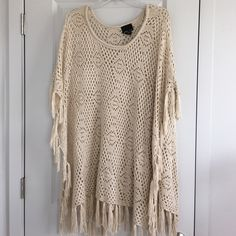 """Crochet Poncho Open crochet poncho not too hot!! Would be so cute over shorts!    Sizing/Info:  •Chest: open  •Length: 39"""" •Material: 100% acrylic  •Fit: fits size medium to 3XL •Condition: Worn once  (No filters used on my photos, but color may vary slightly)   ❌ No trades/No Paypal/No Holds❌ ✅ Bundle Of 3+ Gets 20% Off ✅ ✅ Ships FAST ✅ Sweet Kizz Tops"""