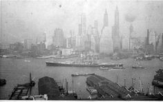 On May 19, 1941, the Battleship NORTH CAROLINA left the New York Navy Yard for the first time and headed down the East River. The ship just left Pier C, Brooklyn Navy Yard. Stephen Hustvedt, the ship's captain's son, age 15, took this photograph of the Battleship from the roof of the Towers Hotel in Brooklyn looking toward the tip of Manhattan. The Battleship headed to Delaware Bay and back for its first trial run in the Atlantic Ocean. The ship is painted in measure 2 camouflage. Battleship North Carolina, Uss North Carolina, The Tower Hotel, Uss Oklahoma, Us Battleships, Delaware Bay, Korean War, Atlantic Ocean, Us Navy