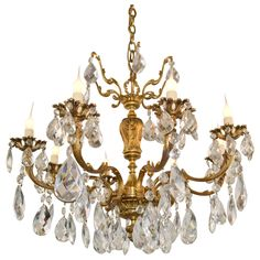 Rich in detail, this eight light brass and crystal chandelier makes an elegant statement. Light glistening through the crystals will enhance your dining room or foyer for years to come. #chandelier #lighting #antique #crystal #decor #design