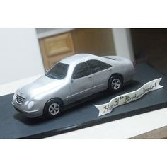 Mercedes Car Cake - Almond cake, wheels are RKT.