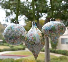 Christmas ornament - DIY Map ornaments. Repurpose maps from your travels as a permanent reminder / souvenir