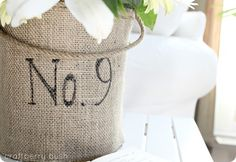 Cover any ugly old container with burlap...and it turns into a pretty container.  I've covered diaper boxes with burlap and they looked great!