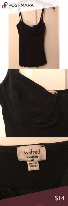 Wilfred Black Corset Camisole Aritzia original Corset Camisole! Rare find! This is an extra extra small! Black, ribbed design on the stomach part, it is tighter! But still in great condition! Please don't ask me to try it because this does not fit around my chest area anymore! Thanks! Aritzia Tops Camisoles