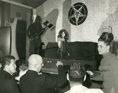 Future Manson Family member Susan Atkins emerging from a coffin during the Witches Revue nightclub show put on by Church of Satan founder Anton Lavey (front, with shaved head), San Francisco, 1968 : HistoryPorn Zeena Lavey, Dark Side, Laveyan Satanism, The Satanic Bible, Sweat Lodge, Satanic Rituals, Charles Manson, Dangerous Minds, Demonology