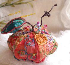 apple pincushion by the amazing fiberluscious on etsy
